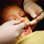 Child Opening Mouth for a Dentist